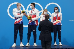 TOKYO, JAPAN - JULY 31: (L-R) Gold medalists Adam Peaty, James Guy, Anna Hopkin and Kathleen Dawson of Team Great Britain during the medal ceremony for the Mixed 4 x 100m Medley Relay Final at Tokyo Aquatics Centre on July 31, 2021 in Tokyo, Japan.