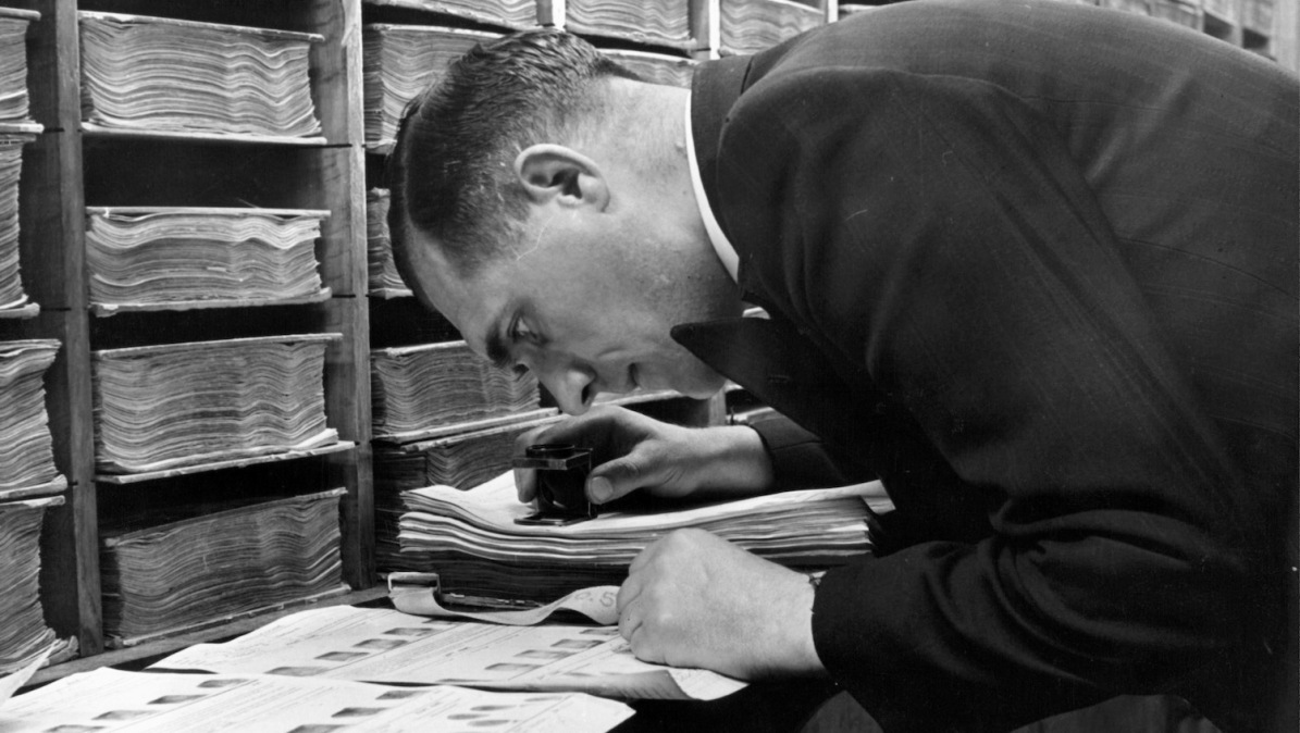A view as a detective examines fingerprints in the Finger Department at Scotland Yard in London, England. Circa 1950. (Photo by Pictorial Parade/Archive Photos/Getty Images)