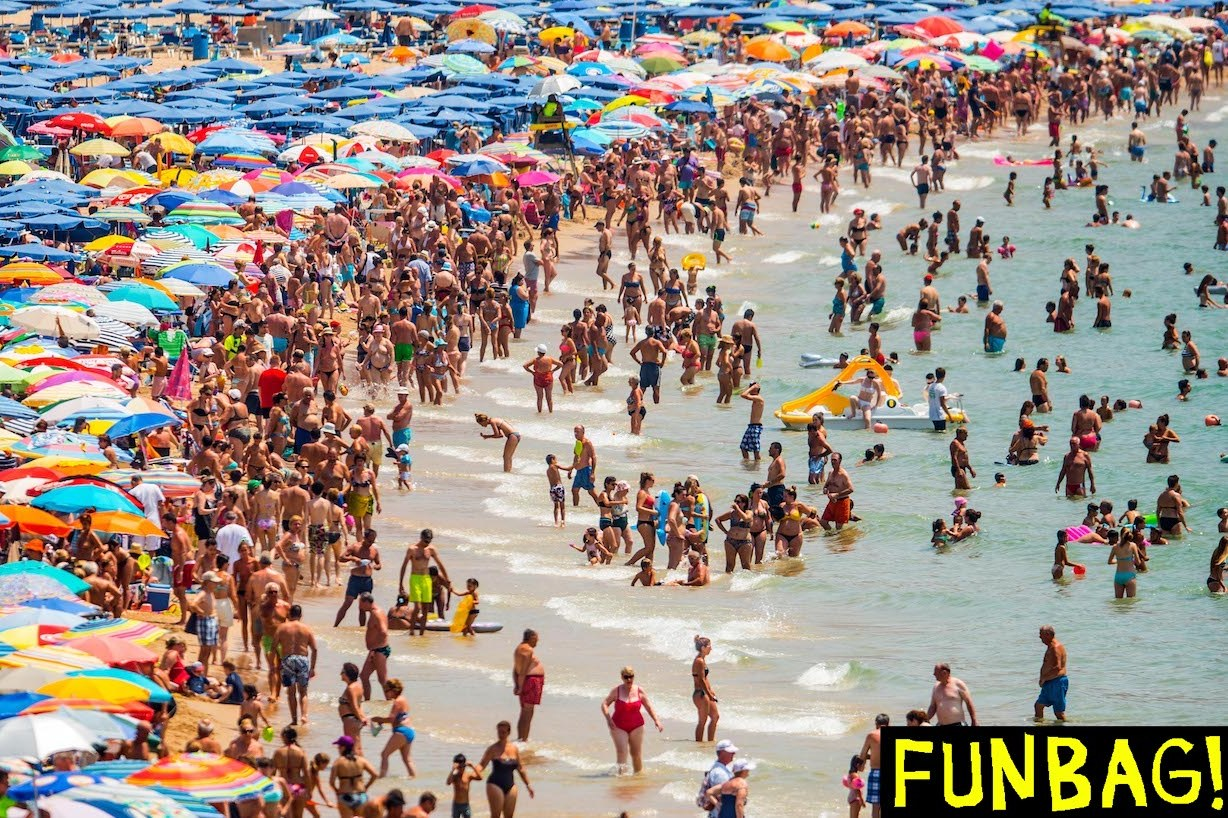 BENIDORM, SPAIN - JULY 22: People sunbathe at Levante Beach on July 22, 2015 in Benidorm, Spain. Spain has set a new record for visitors, with 29.2 million visitors in June, 4.2% more than the same period in 2014. Spain is also expected to be the main destination of tourists seeking a value-for-money all-inclusive holiday after the Tunisia attack. (Photo by David Ramos/Getty Images)