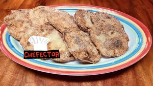 A plate of fried green tomatoes, with a Chefector badge