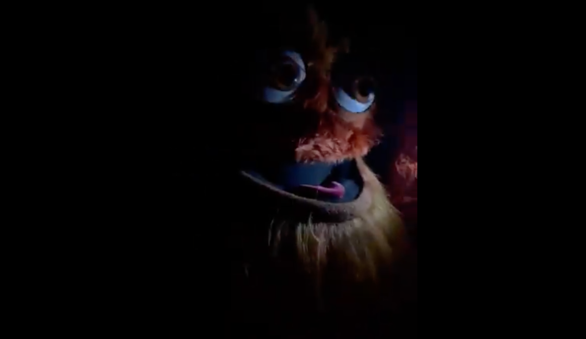An image of Gritty in the dark looking vaguely strange and scary, if you did not know it was Gritty.