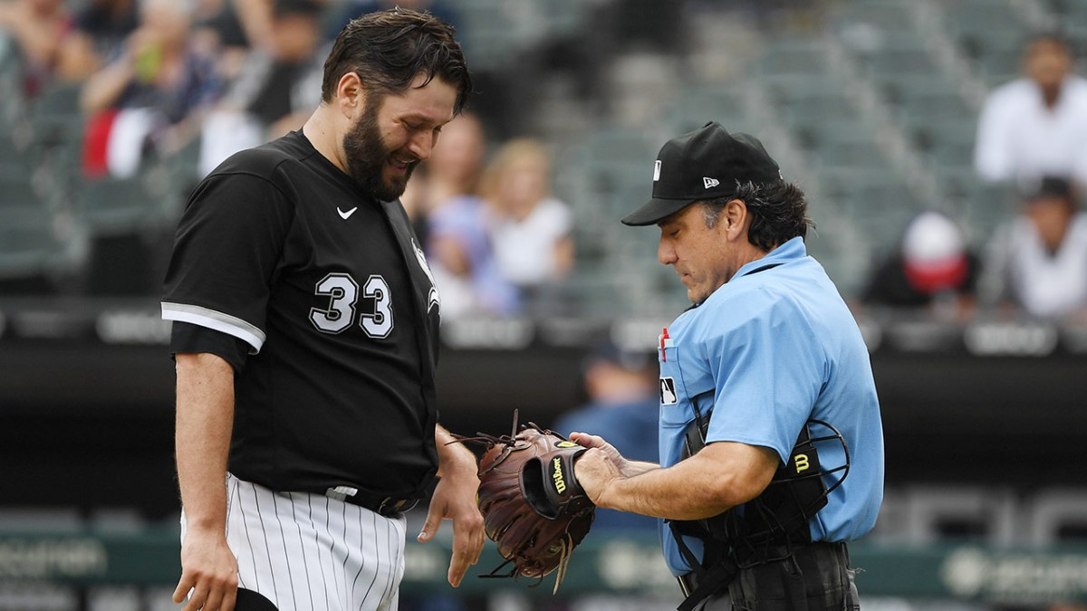 Lance Lynn's hat is checked by an umpire