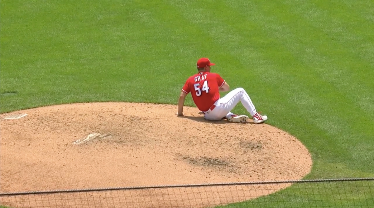 Reds pitcher Sonny Gray rubs his butt against the mound during Sunday's game.