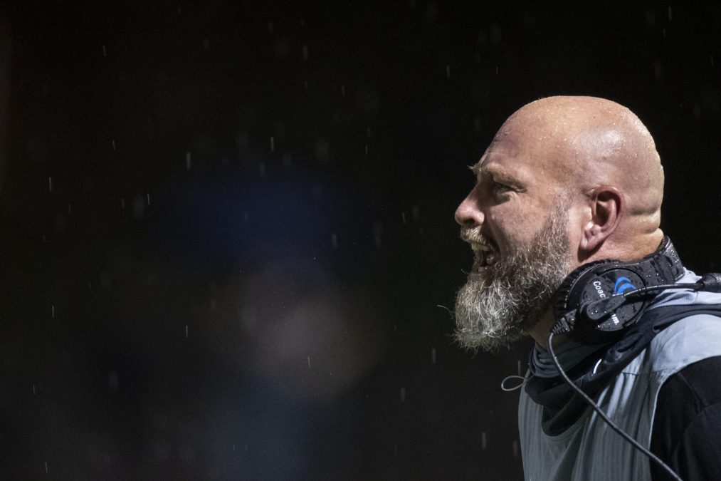 Trent Dilfer screams from the sideline of a high school football game.