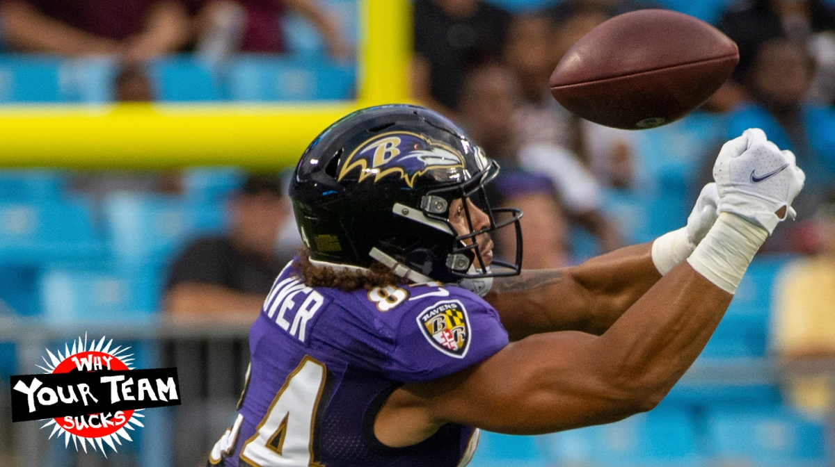 CHARLOTTE, NC - AUGUST 21: Josh Oliver #84 of the Baltimore Ravens attempts to make a catch against the Carolina Panthers during the first half of a NFL preseason game at Bank of America Stadium on August 21, 2021 in Charlotte, North Carolina. (Photo by Chris Keane/Getty Images)
