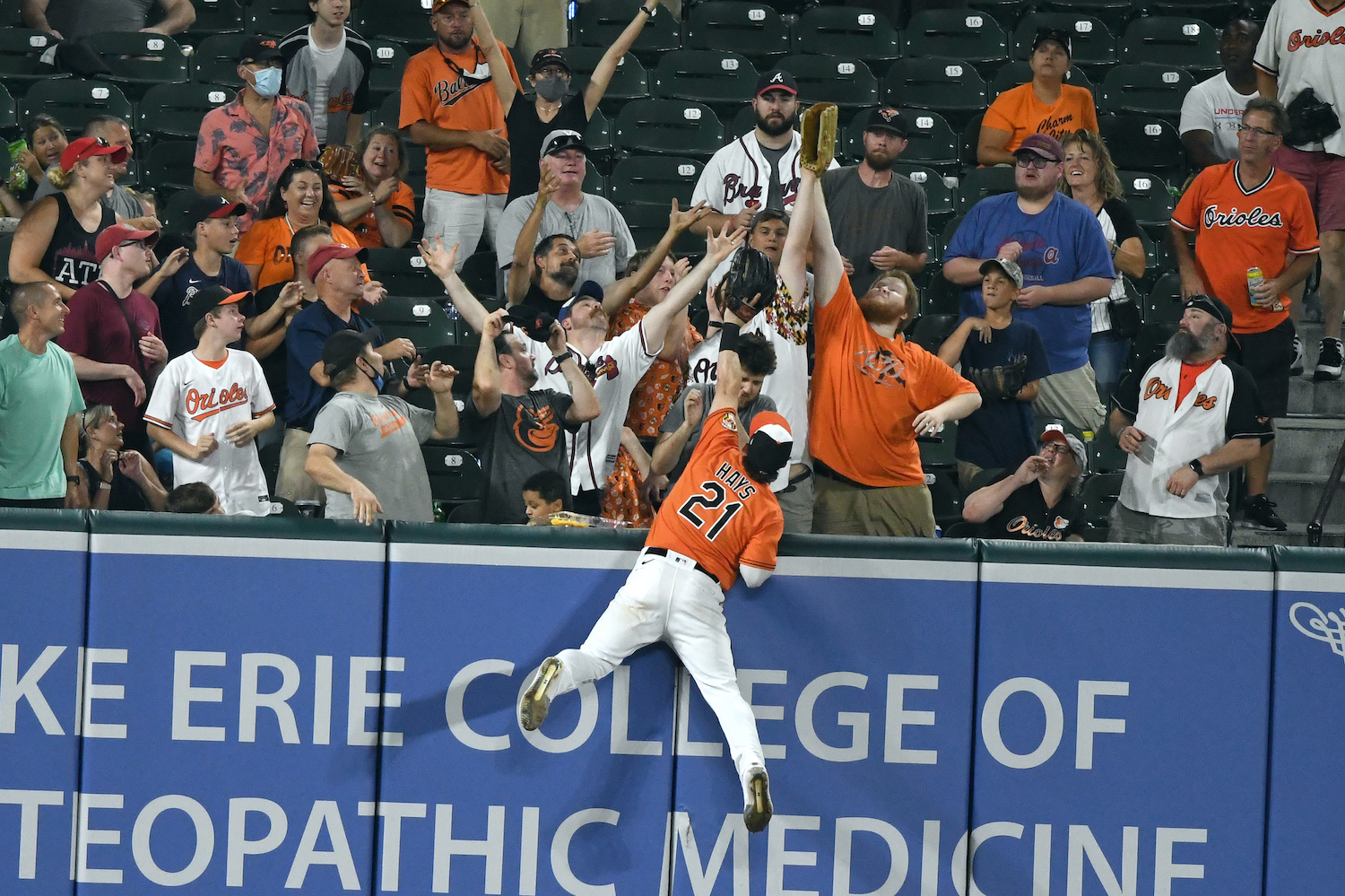Austin Hays #21 of the Baltimore Orioles can not get to a home run hit ball by Austin Riley #27 (not pictured) of the Atlanta Braves fifth inning during a baseball game at Oriole Park at Camden Yards on August 21, 2021 in Baltimore, Maryland.