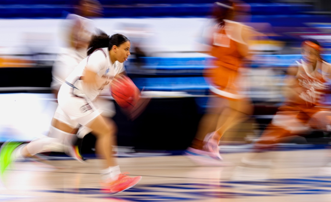 Destiny Littleton #11 of the South Carolina Gamecocks controls the ball during the second half against the Texas Longhorns in the Elite Eight round of the NCAA Women's Basketball Tournament at the Alamodome on March 30, 2021 in San Antonio, Texas.