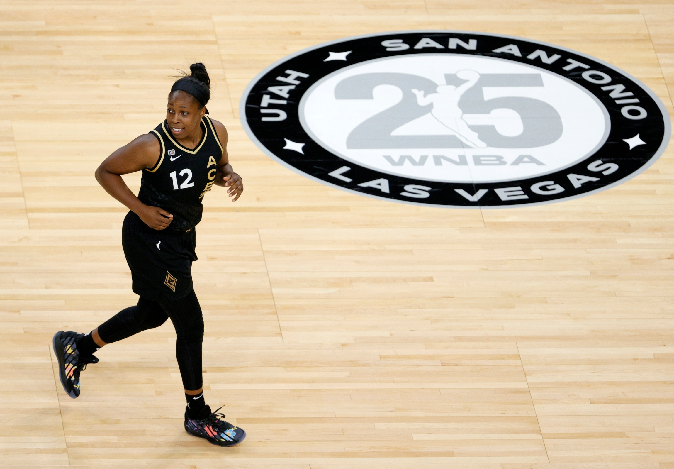Chelsea Gray #12 of the Las Vegas Aces runs back on defense after scoring against the Los Angeles Sparks during their game at Michelob ULTRA Arena on May 21, 2021 in Las Vegas, Nevada. The Aces defeated the Sparks 97-69.