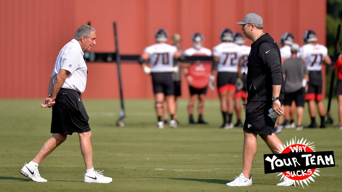 FLOWERY BRANCH, GA - JULY 29: Team owner Arthur Blank (l) of the Atlanta Falcons walks toward Head Coach Arthur Smith on the first day of training camp at IBM Performance Field on July 29, 2021 in Flowery Branch, Georgia. (Photo by Edward M. Pio Roda/Getty Images)