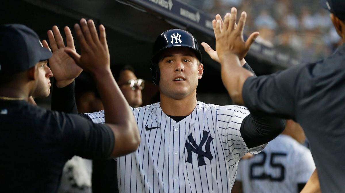 NEW YORK, NEW YORK - AUGUST 03: Anthony Rizzo #48 of the New York Yankees celebrates in the dugout with his teammates after scoring a run during the third inning against the Baltimore Orioles at Yankee Stadium on August 03, 2021 in New York City. (Photo by Jim McIsaac/Getty Images)