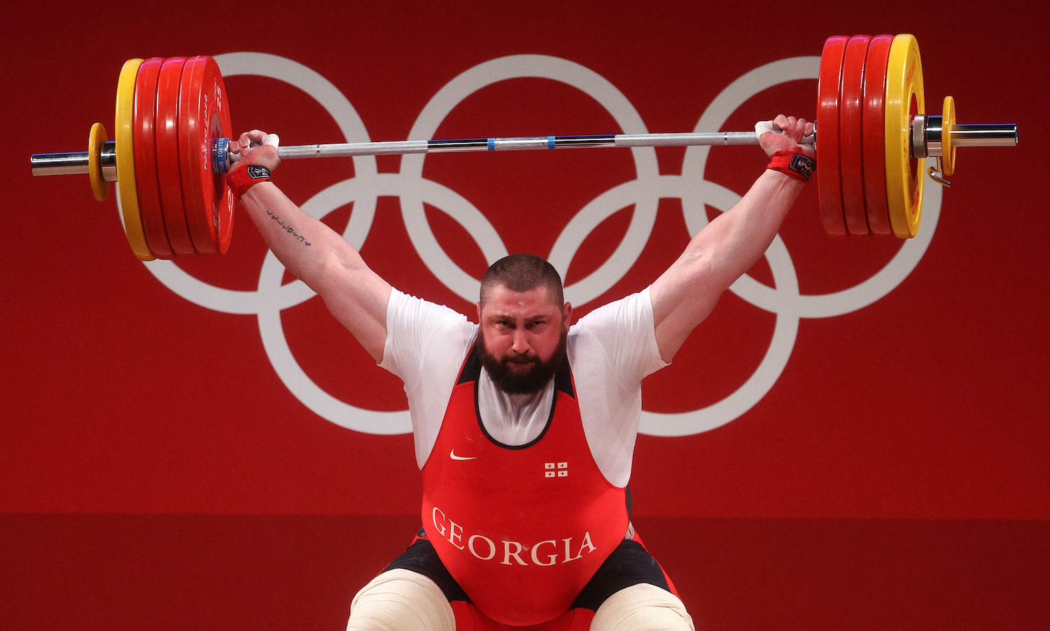 TOKYO, JAPAN - AUGUST 04: Lasha Talakhadze of Team Georgia competes during the Weightlifting - Men's 109kg+ Group A on day twelve of the Tokyo 2020 Olympic Games at Tokyo International Forum on August 04, 2021 in Tokyo, Japan. (Photo by Chris Graythen/Getty Images)
