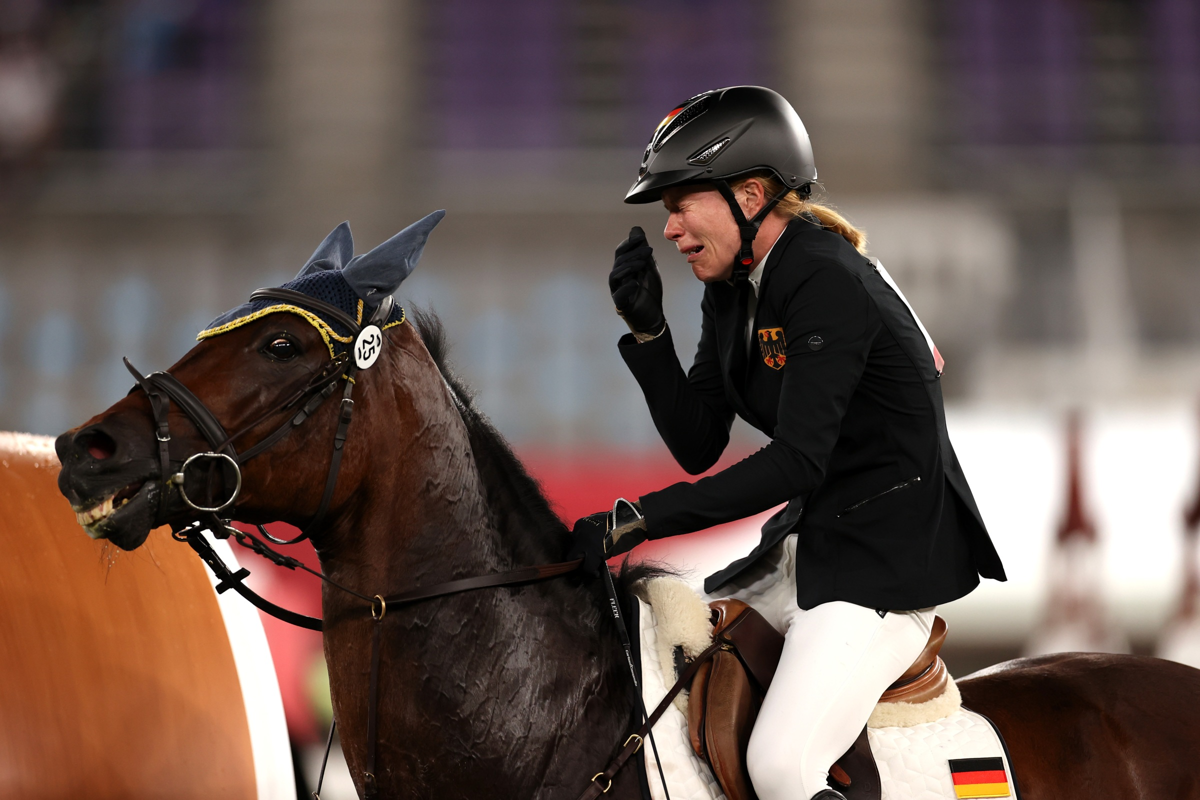 CHOFU, JAPAN - AUGUST 06: Annika Schleu of Team Germany looks dejected following her run in the Riding Show Jumping of the Women's Modern Pentathlon on day fourteen of the Tokyo 2020 Olympic Games