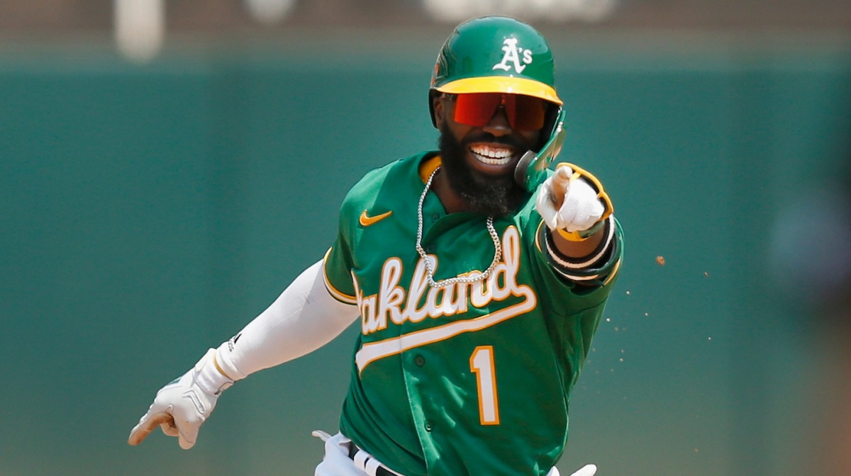 OAKLAND, CALIFORNIA - AUGUST 07: Josh Harrison #1 of the Oakland Athletics celebrates after hitting a two-run home run in the bottom of the fifth inning against the Texas Rangers at RingCentral Coliseum on August 07, 2021 in Oakland, California. (Photo by Lachlan Cunningham/Getty Images)