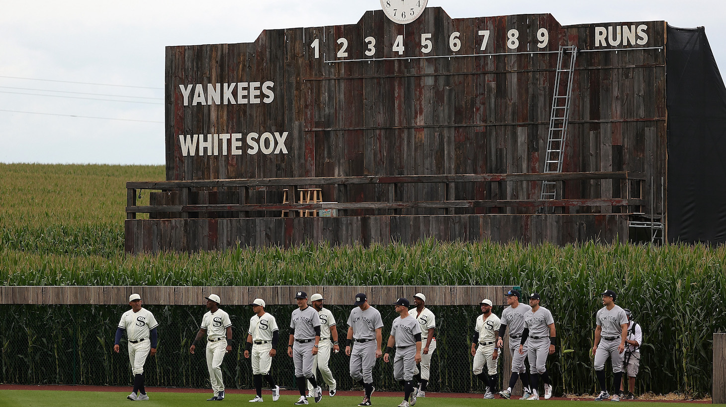 DYERSVILLE, IOWA - AUGUST 12: Members of the Chicago White Sox and the New York Yankees take the field prior to a game at the Field of Dreams on August 12, 2021 in Dyersville, Iowa. (Photo by Stacy Revere/Getty Images)