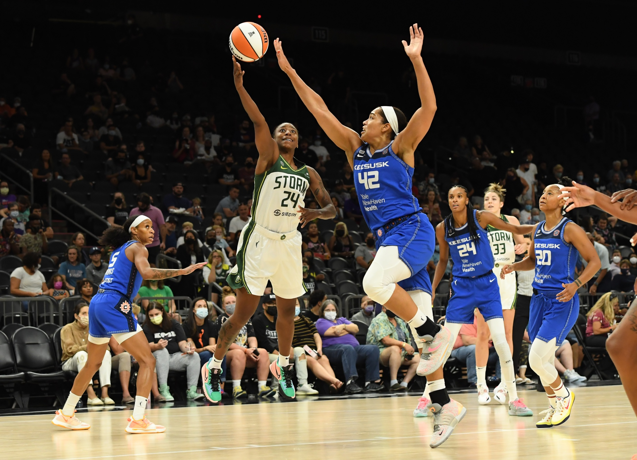 Jewell Loyd #24 of the Seattle Storm attempts a layup while being defended by Brionna Jones #42 of the Connecticut Sun during the first half of the 2021 Commissioner's Cup Championship Game at Footprint Center on August 12, 2021 in Phoenix, Arizona.