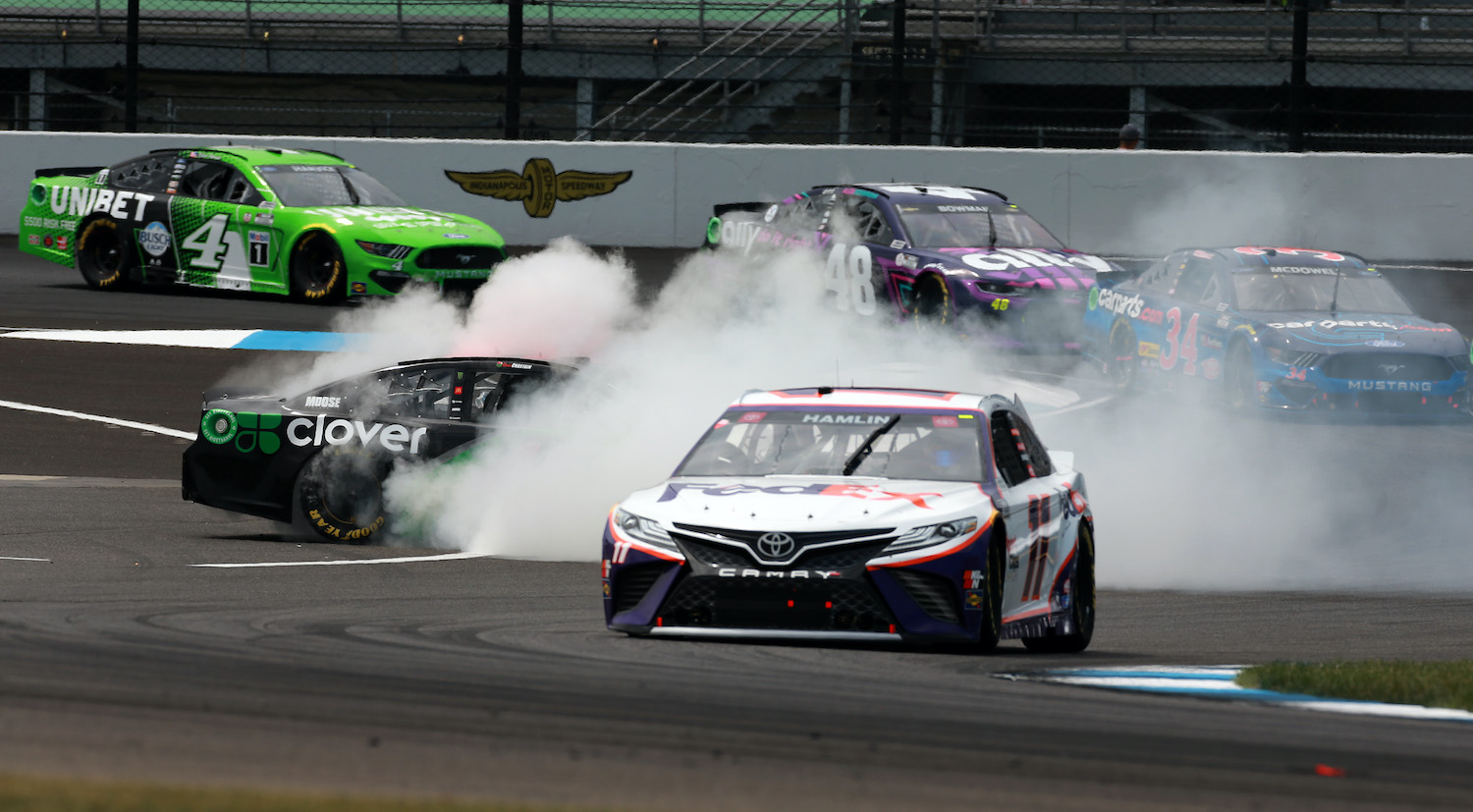 INDIANAPOLIS, INDIANA - AUGUST 15: Denny Hamlin, driver of the #11 FedEx Ground Toyota, Michael McDowell, driver of the #34 CarParts.com Ford, Alex Bowman, driver of the #48 Ally Chevrolet, and Kevin Harvick, driver of the #4 Unibet Ford, avoid Ross Chastain, driver of the #42 Clover Chevrolet, spin during the NASCAR Cup Series Verizon 200 at the Brickyard at Indianapolis Motor Speedway on August 15, 2021 in Indianapolis, Indiana. (Photo by Sean Gardner/Getty Images)