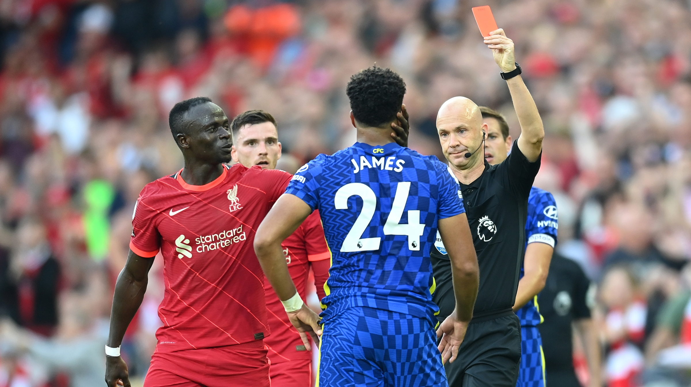 Reece James of Chelsea is shown a Red Card by Match Referee Anthony Taylor during the Premier League match between Liverpool and Chelsea at Anfield on August 28, 2021 in Liverpool, England.