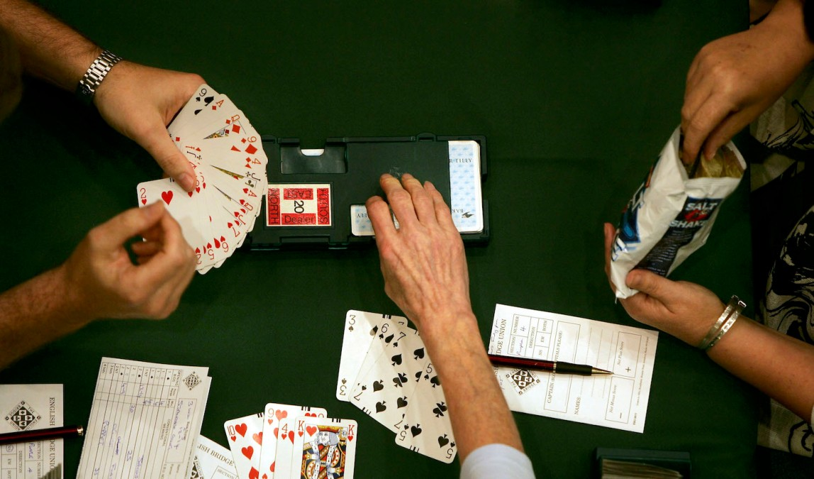 People play in an open round of Europe's biggest single venue bridge competition at the Metropole Hotel August 19, 2005 in Brighton, England. The game of Bridge is believed to share the same mental ability that is used to trade shares and is played regularly by over a million people. (Photo by Bruno Vincent/Getty Images)