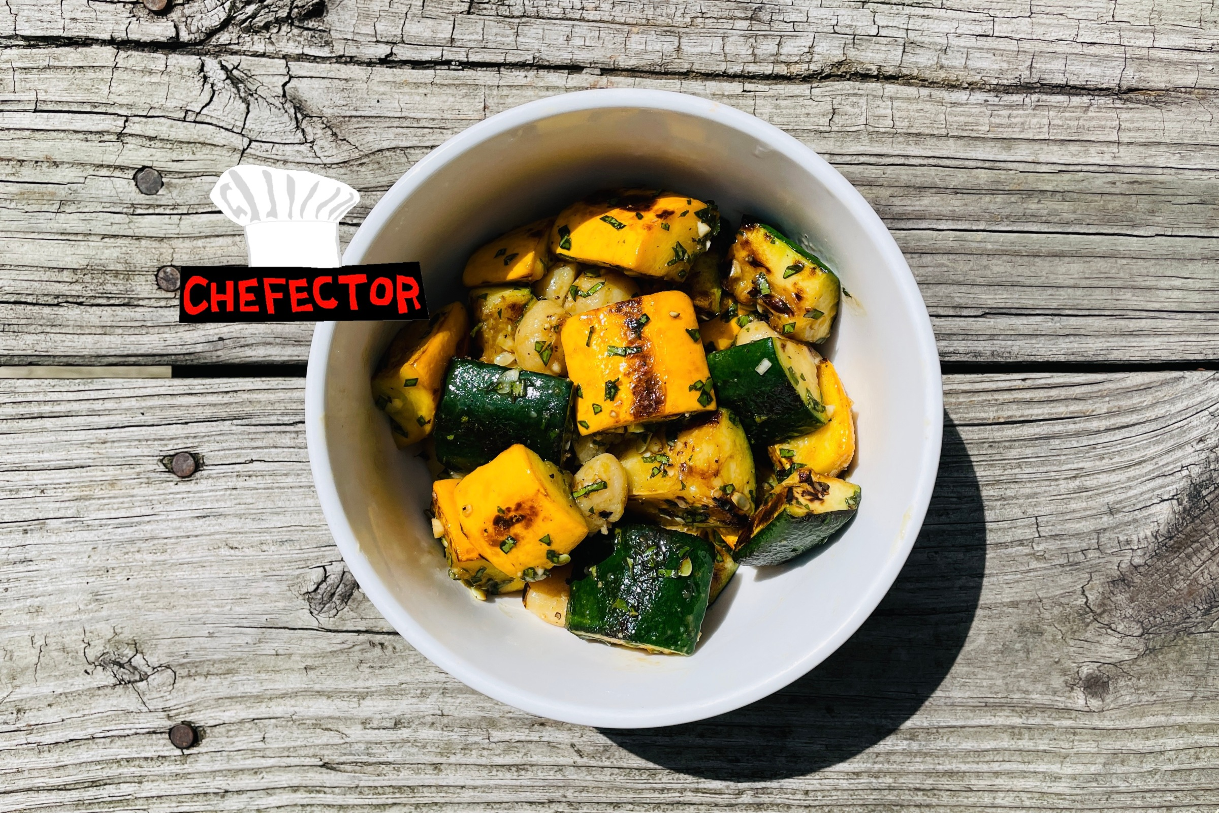 A bowl of squash with gnocchi and basil