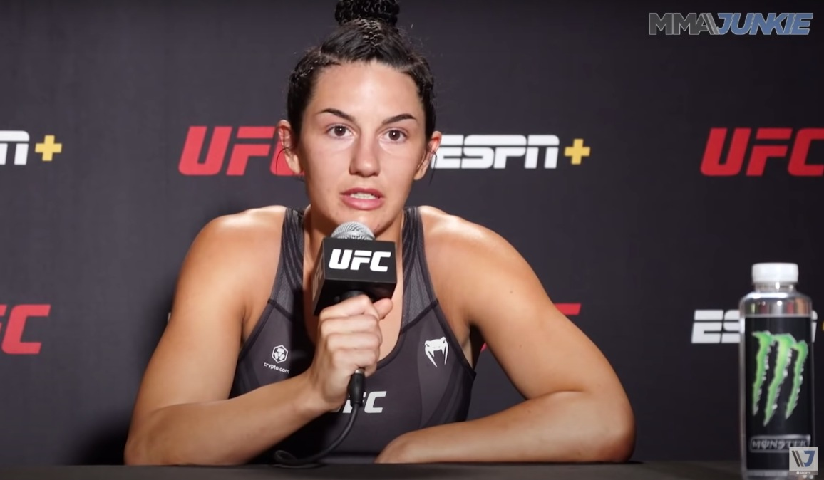 Buys giving her post-fight presser.