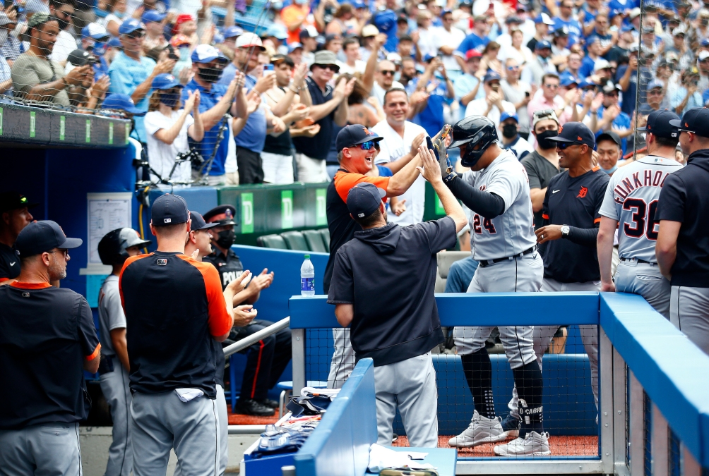 Miguel Cabrera #24 of the Detroit Tigers high fives Manager A.J. Hinch after hitting his 500th career home run in the sixth inning during a MLB game against the Toronto Blue Jays at Rogers Centre on August 22, 2021 in Toronto, Ontario, Canada.