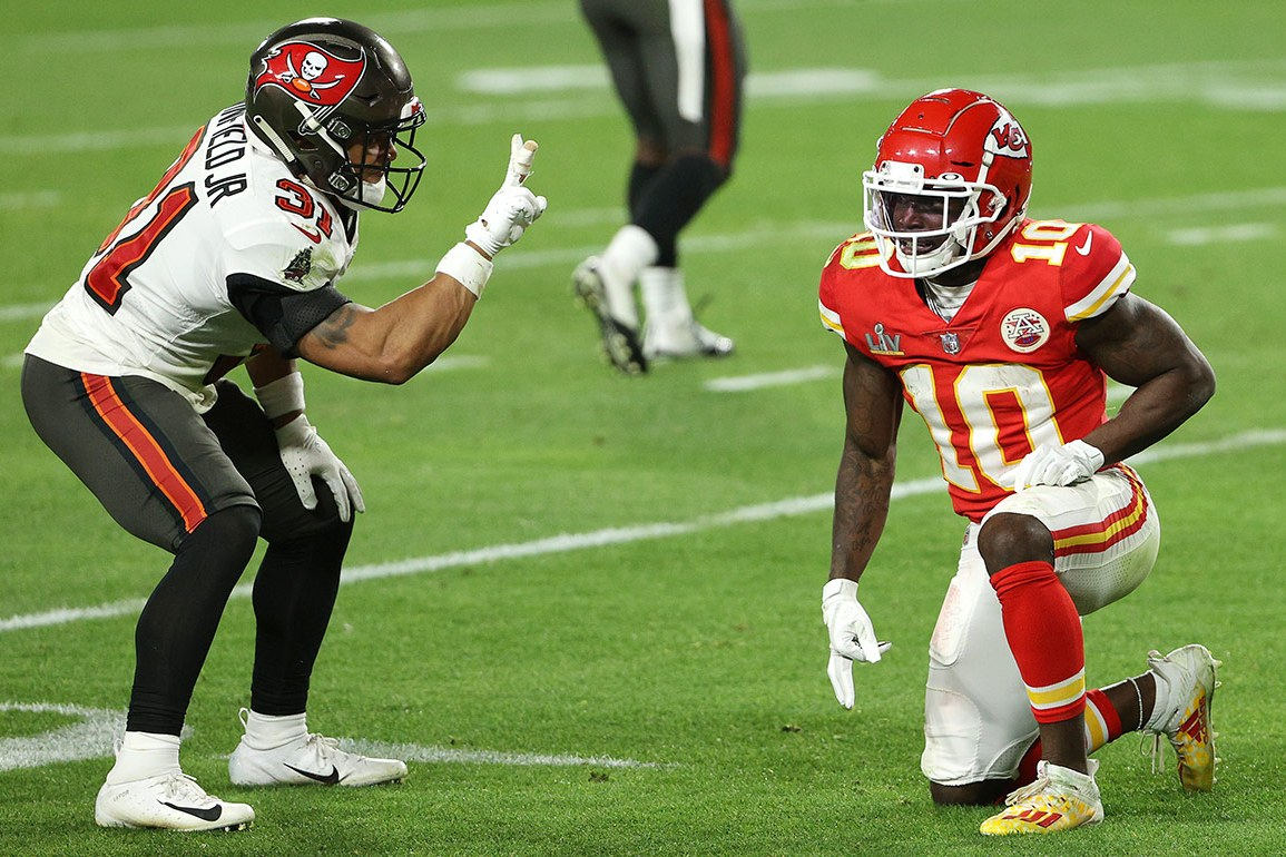 TAMPA, FLORIDA - FEBRUARY 07: Antoine Winfield Jr. #31 of the Tampa Bay Buccaneers taunts Tyreek Hill #10 of the Kansas City Chiefs during the fourth quarter in Super Bowl LV at Raymond James Stadium on February 07, 2021 in Tampa, Florida.