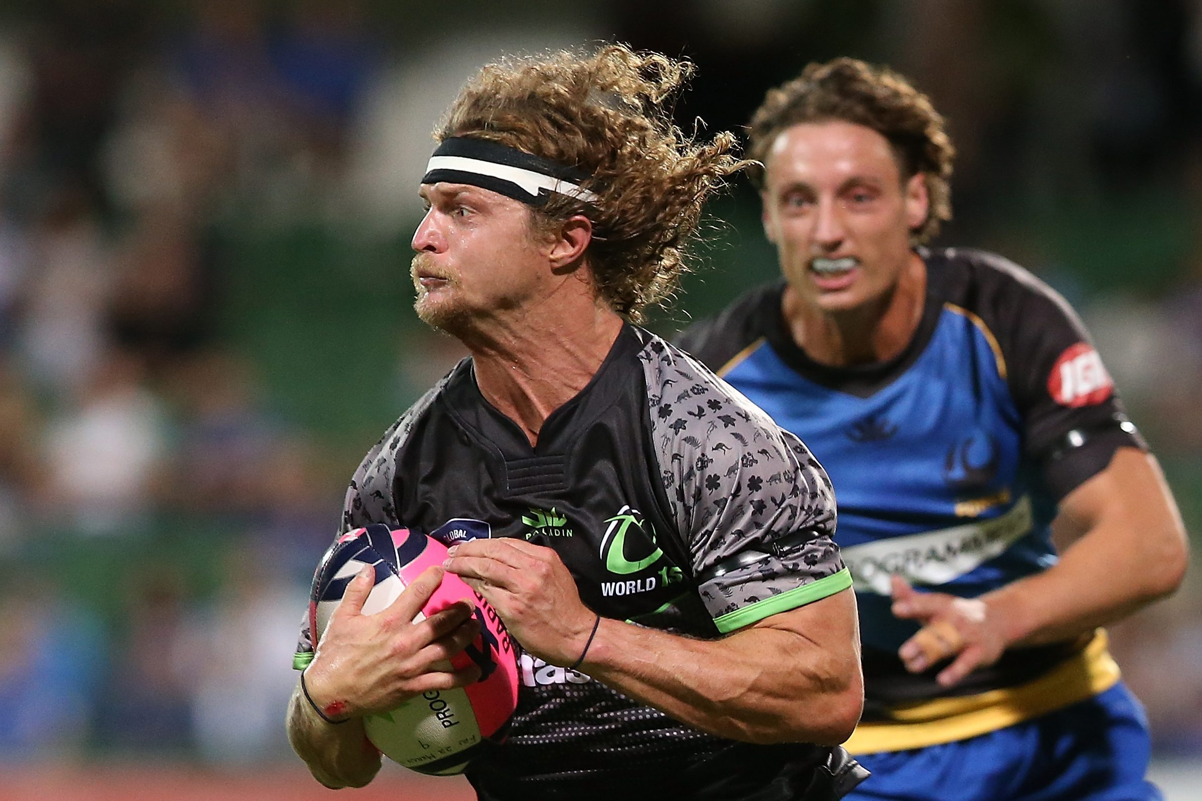 Nick Cummins, Australian rugby guy, runs with the ball in 2019