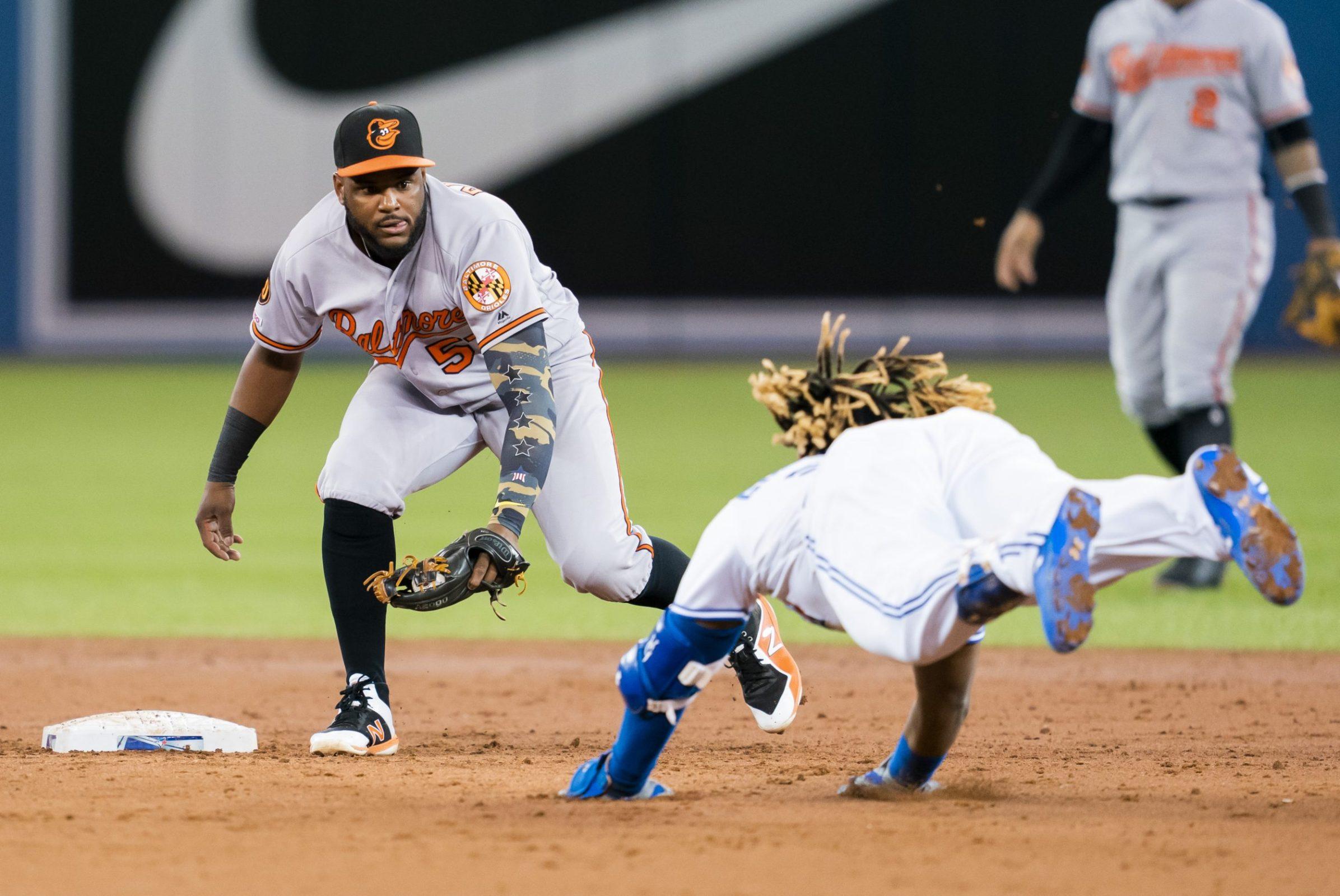 Vladimir Guerrero Jr. slides into second base against the Orioles.