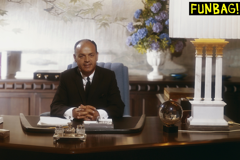 Businessman sitting in office, portrait