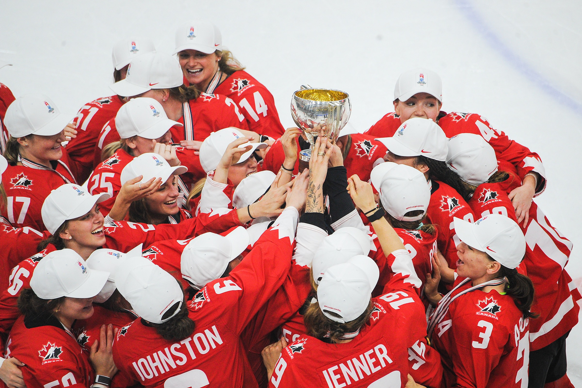 Team Canada hoists the championship trophy after their victory over United Sates in the 2021 IIHF Women's World Championship gold medal game played at WinSport Arena on August 31, 2021 in Calgary, Canada.