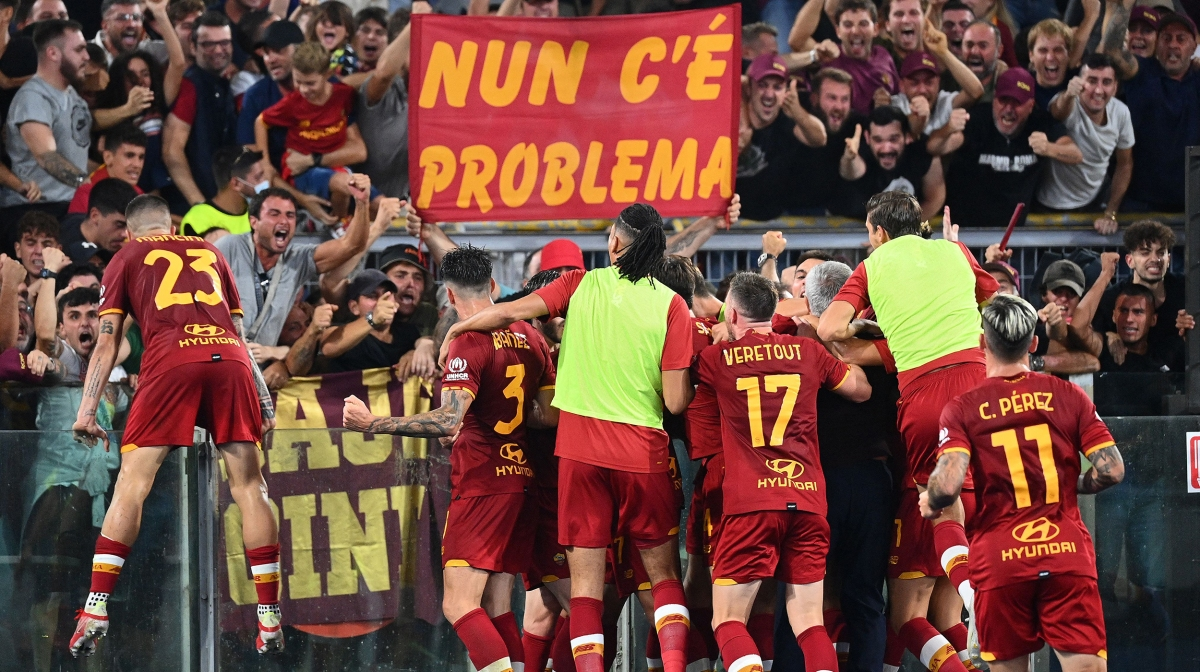 Roma's players celebrate after scoring during the Italian Serie A football match between AS Roma and Sassuolo at the Olympic stadium in Rome on September 12, 2021.