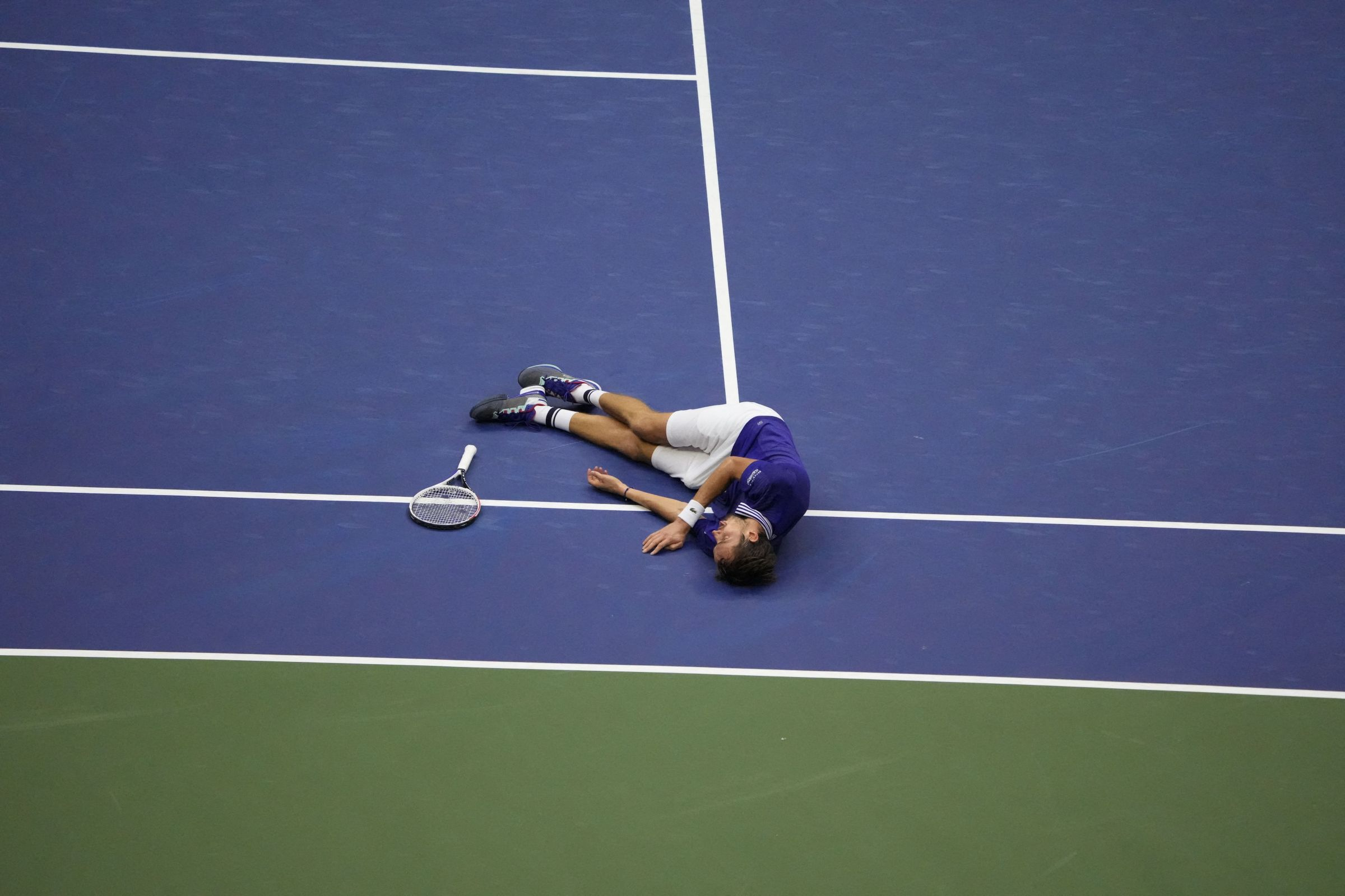 Daniil Medvedev collapses on the court after winning the 2021 U.S. Open.