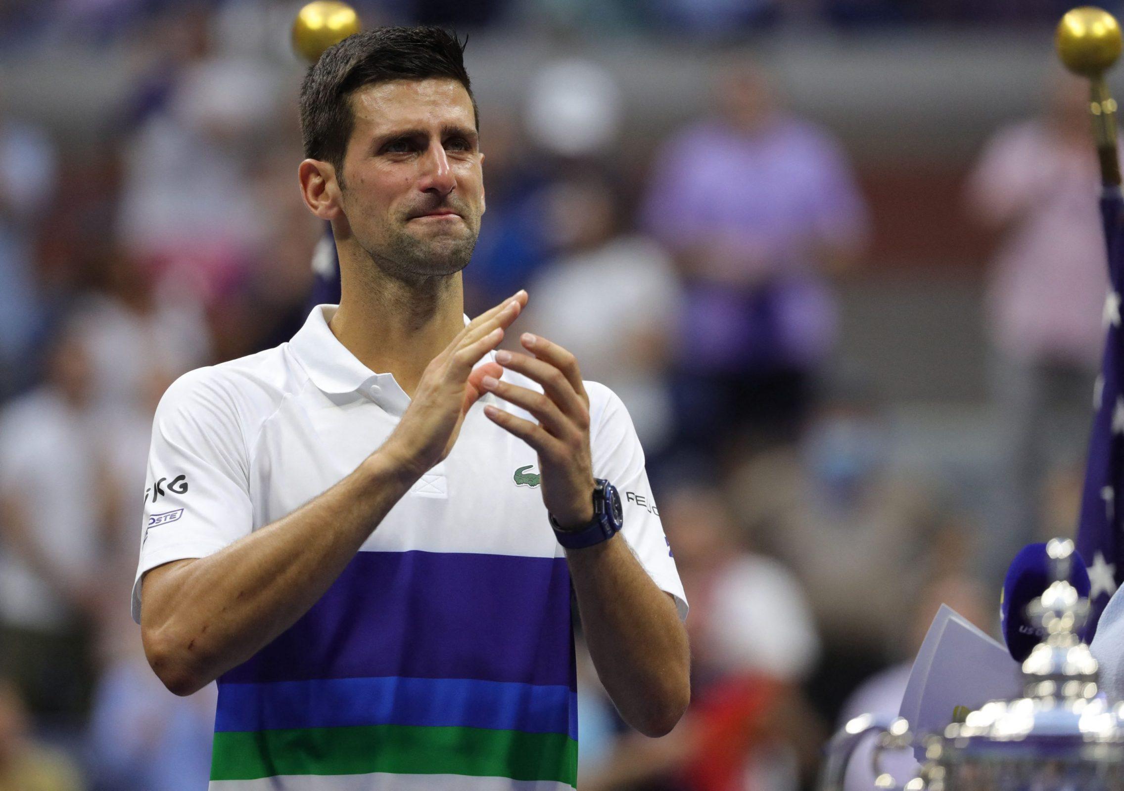 Novak Djokovic applauds the crowd