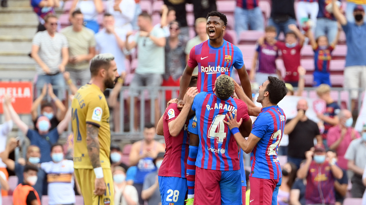 Barcelona's Spanish midfielder Ansu Fati (TOP) celebrates scoring his team's third goal during the Spanish League football match between FC Barcelona and Levante UD at the Camp Nou stadium in Barcelona on September 26, 2021.