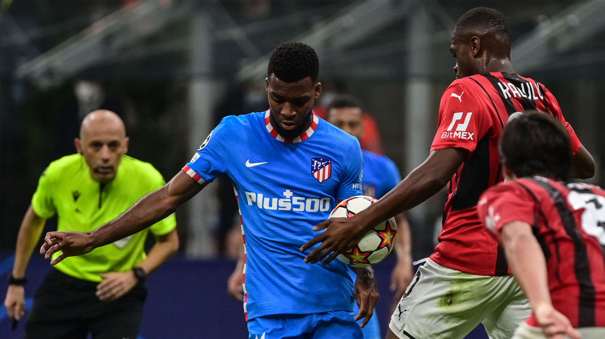 AC Milan's French defender Pierre Kalulu (2ndR) touches the ball with the hand in the penalty area during the UEFA Champions League Group B football match between AC Milan and Atletico Madrid on September 28, 2021 at the San Siro stadium in Milan.
