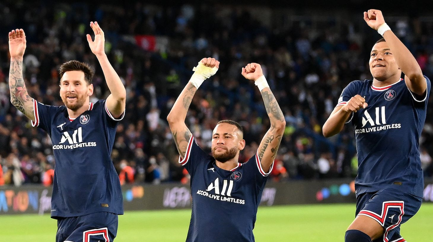 Paris Saint-Germain's Argentinian forward Lionel Messi, Paris Saint-Germain's Brazilian forward Neymar and Paris Saint-Germain's French forward Kylian Mbappe celebrate at the end of the UEFA Champions League first round group A football match between Paris Saint-Germain's (PSG) and Manchester City at The Parc des Princes stadium in Paris on September 28, 2021.