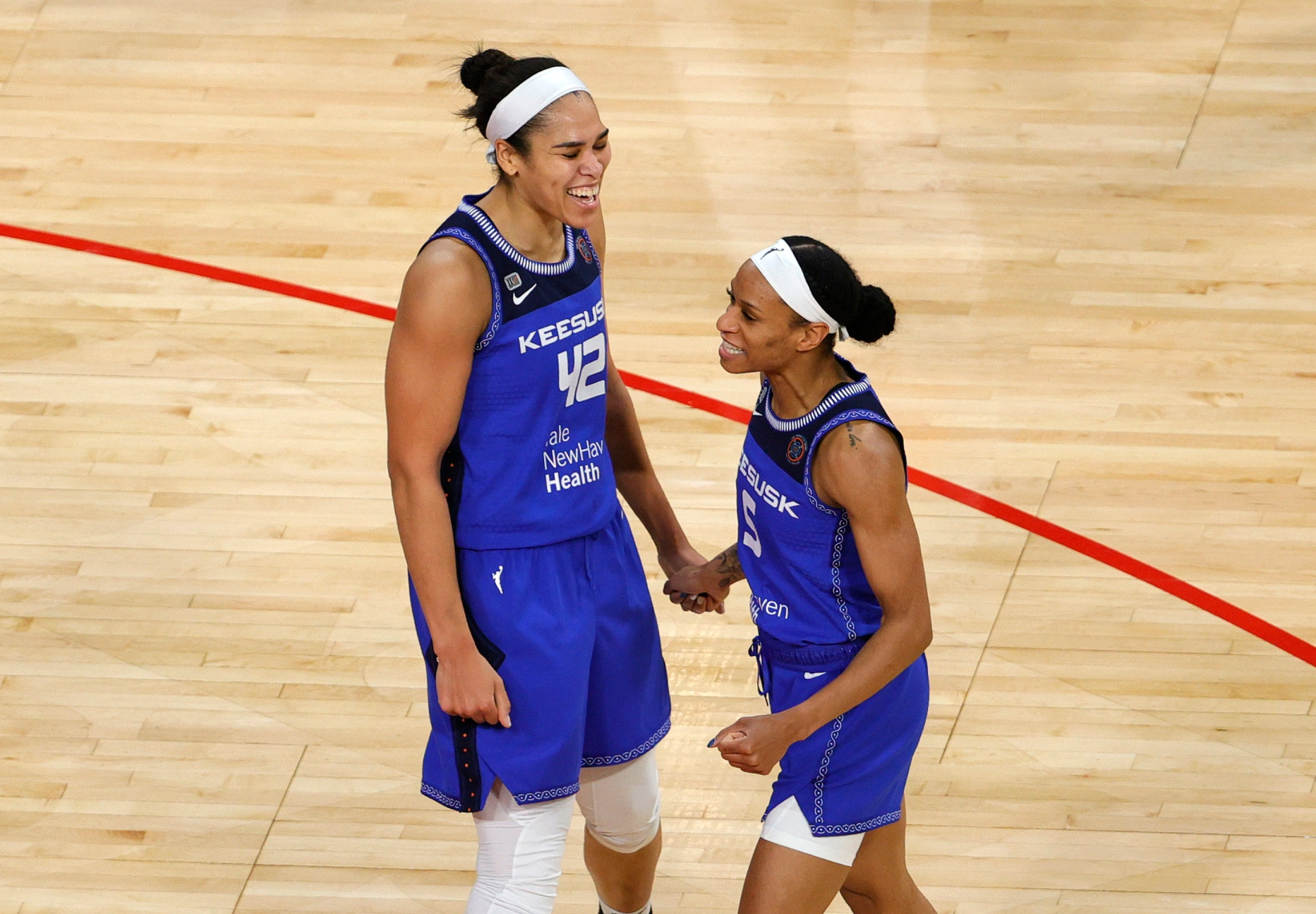 Brionna Jones #42 and Jasmine Thomas #5 of the Connecticut Sun celebrate on the court after Jones scored against the Las Vegas Aces and was fouled during their game at Michelob ULTRA Arena on May 23, 2021 in Las Vegas, Nevada. The Sun defeated the Aces 72-65.