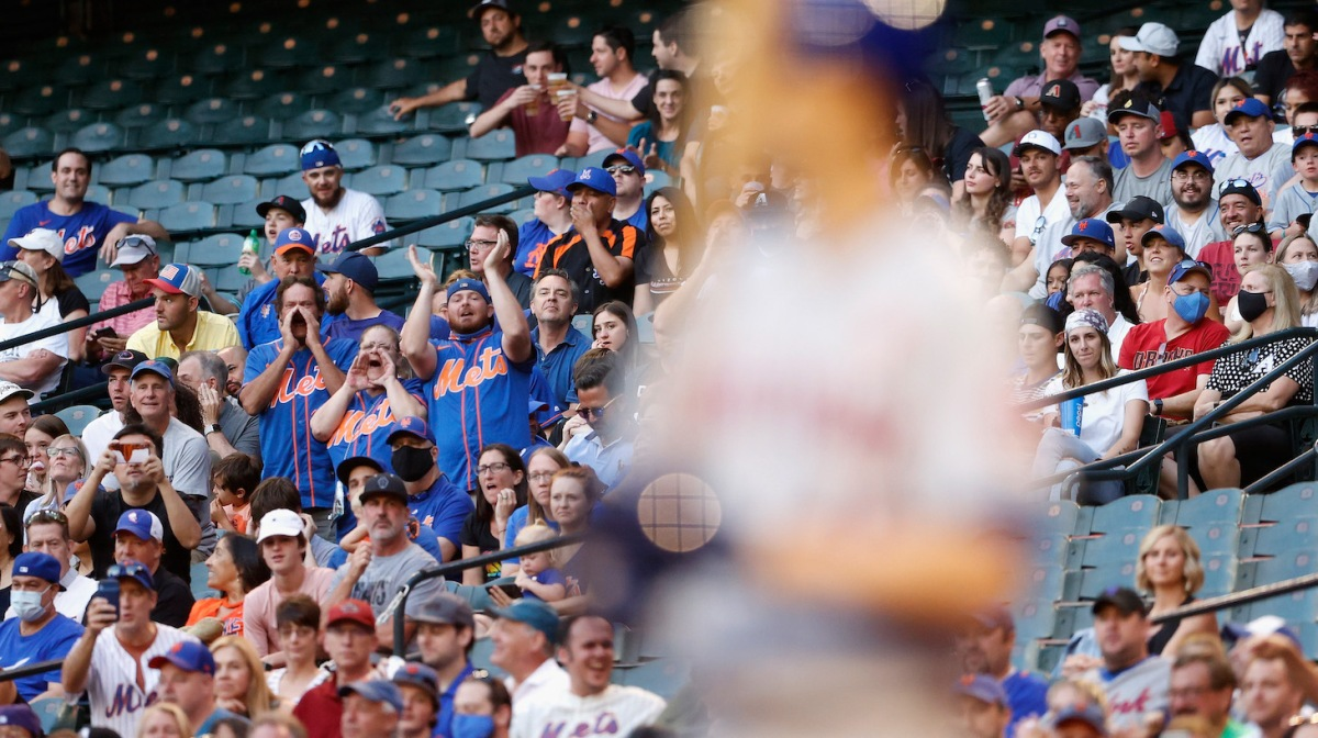 PHOENIX, ARIZONA - MAY 31: Fans of the New York Mets cheer as Jacob deGrom #48 bats against the Arizona Diamondbacks during the third inning of the MLB game at Chase Field on May 31, 2021 in Phoenix, Arizona. (Photo by Christian Petersen/Getty Images)