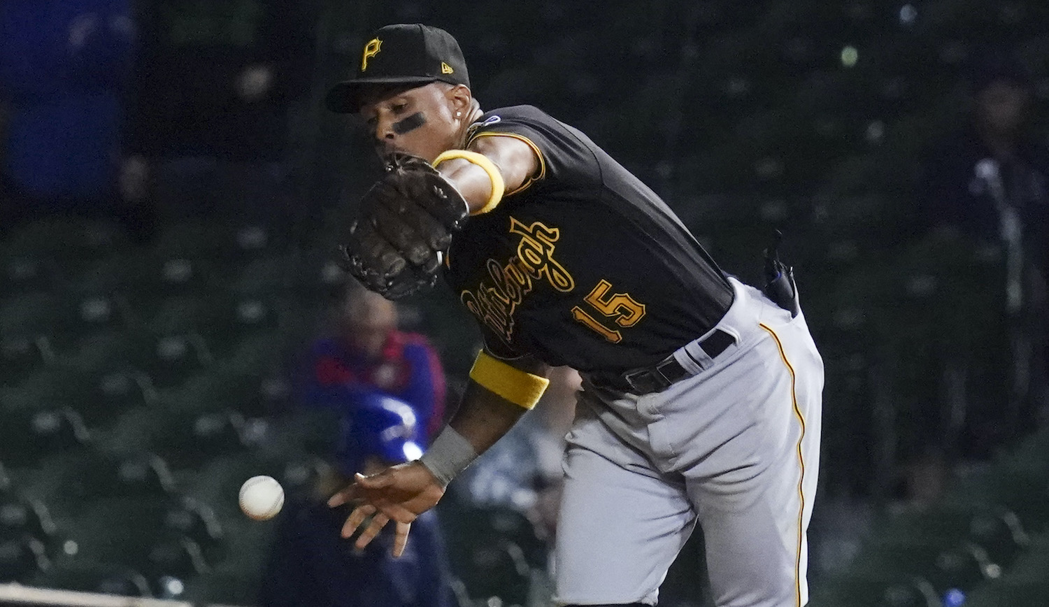 CHICAGO, ILLINOIS - SEPTEMBER 02: Wilmer Difo #15 of the Pittsburgh Pirates commits an error in the 11th inning against the Chicago Cubs at Wrigley Field on September 02, 2021 in Chicago, Illinois. The Cubs won 6-5 in 11 innings. (Photo by Nuccio DiNuzzo/Getty Images)