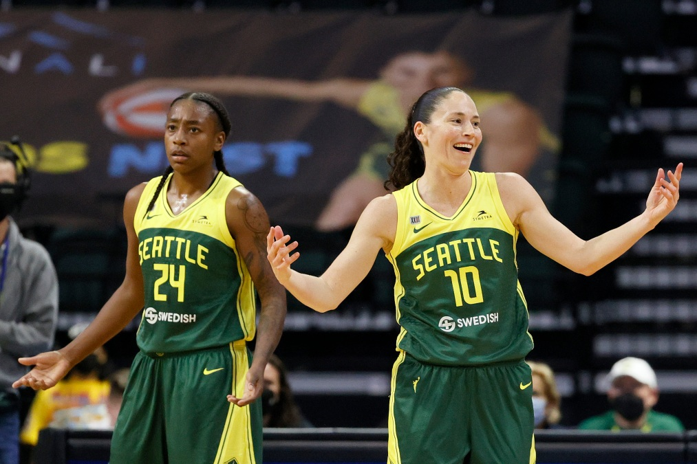 Jewell Loyd #24 and Sue Bird #10 of the Seattle Storm react during the second quarter against the Washington Mystics at Angel of the Winds Arena on September 07, 2021 in Everett, Washington.