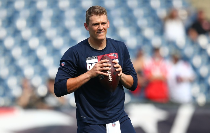 Mac Jones #10 of the New England Patriots warms up prior to the game against the Miami Dolphins at Gillette Stadium on September 12, 2021 in Foxborough, Massachusetts.