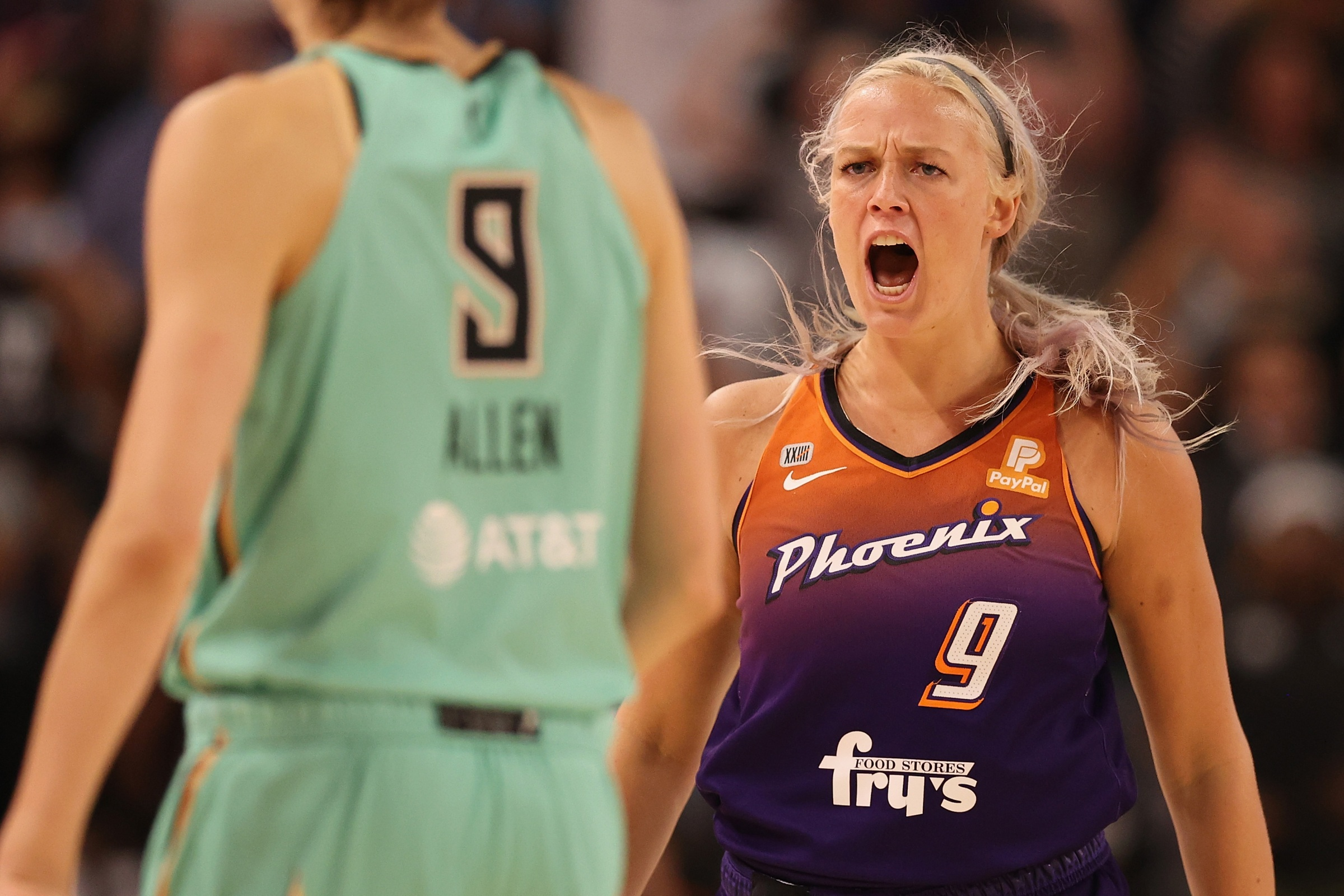 Sophie Cunningham #9 of the Phoenix Mercury reacts after hitting a three-point shot over Rebecca Allen #9 of the New York Liberty during the second half of the first round WNBA playoffs at Grand Canyon University Arena on September 23, 2021 in Phoenix, Arizona. The Mercury defeated the Liberty 83-82.