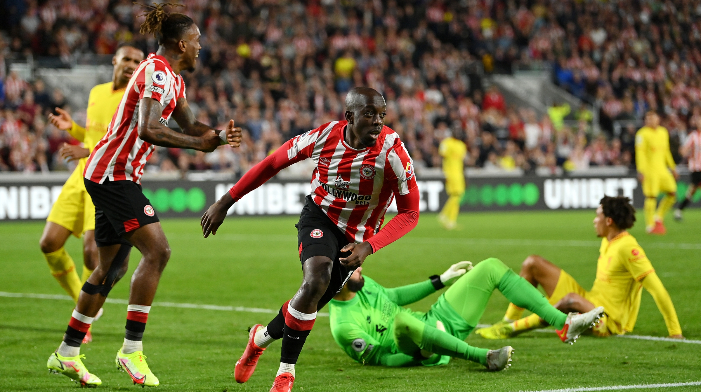 Yoane Wissa of Brentford celebrates scoring his sides third goal during the Premier League match between Brentford and Liverpool at Brentford Community Stadium on September 25, 2021 in Brentford, England.