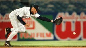 Derek Jeter, New York Yankees, stretches toward a ground ball