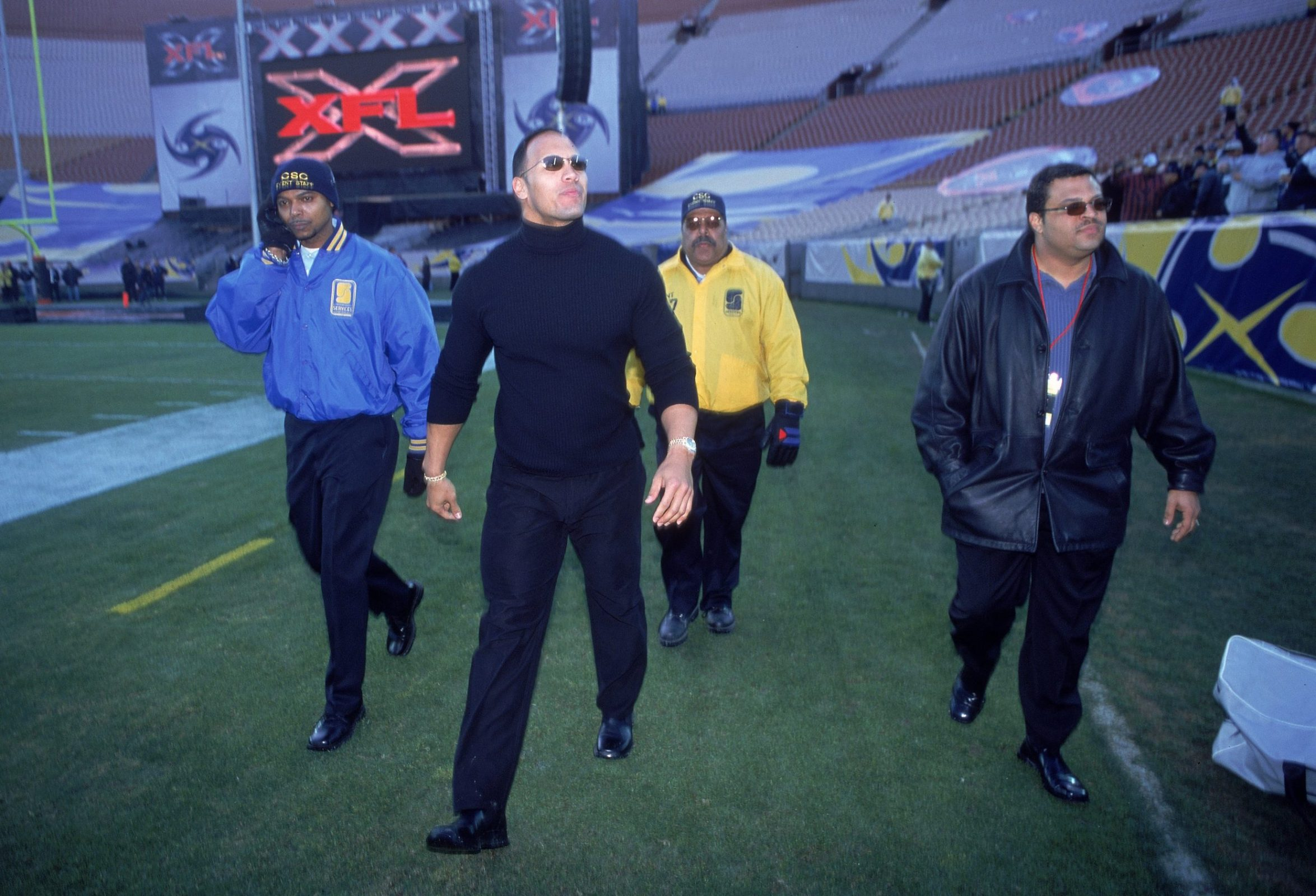 The Rock greets fans before an XFL game