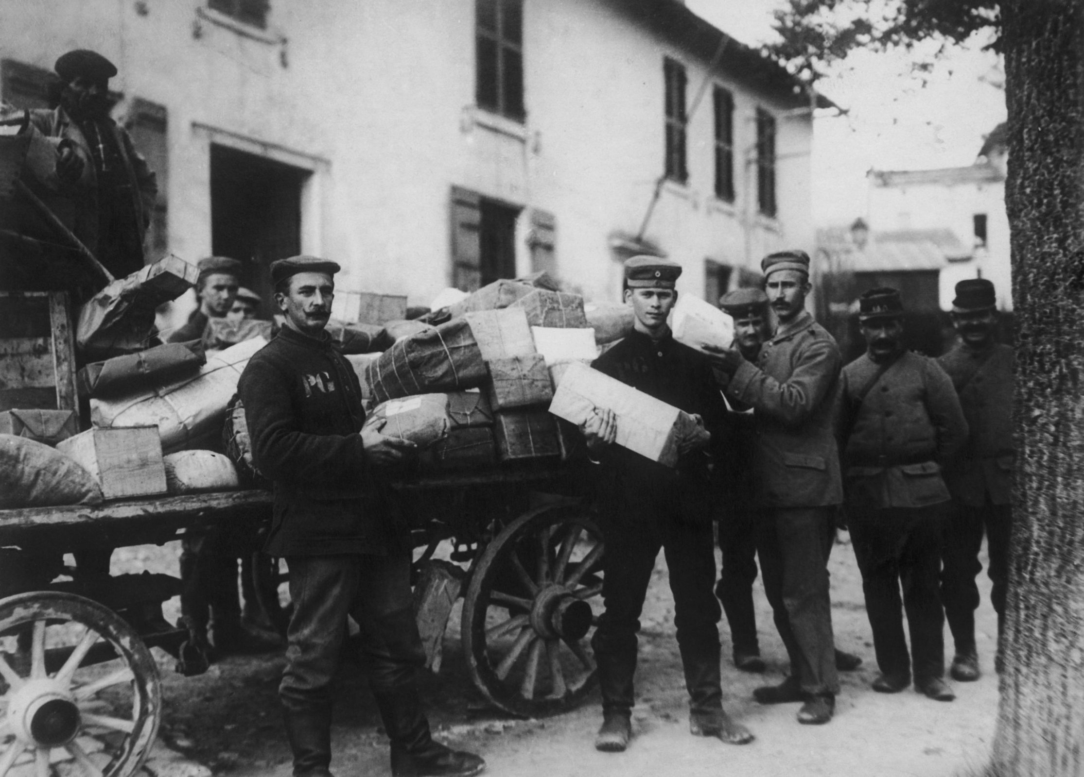 Prisoners sort mail during World War II.