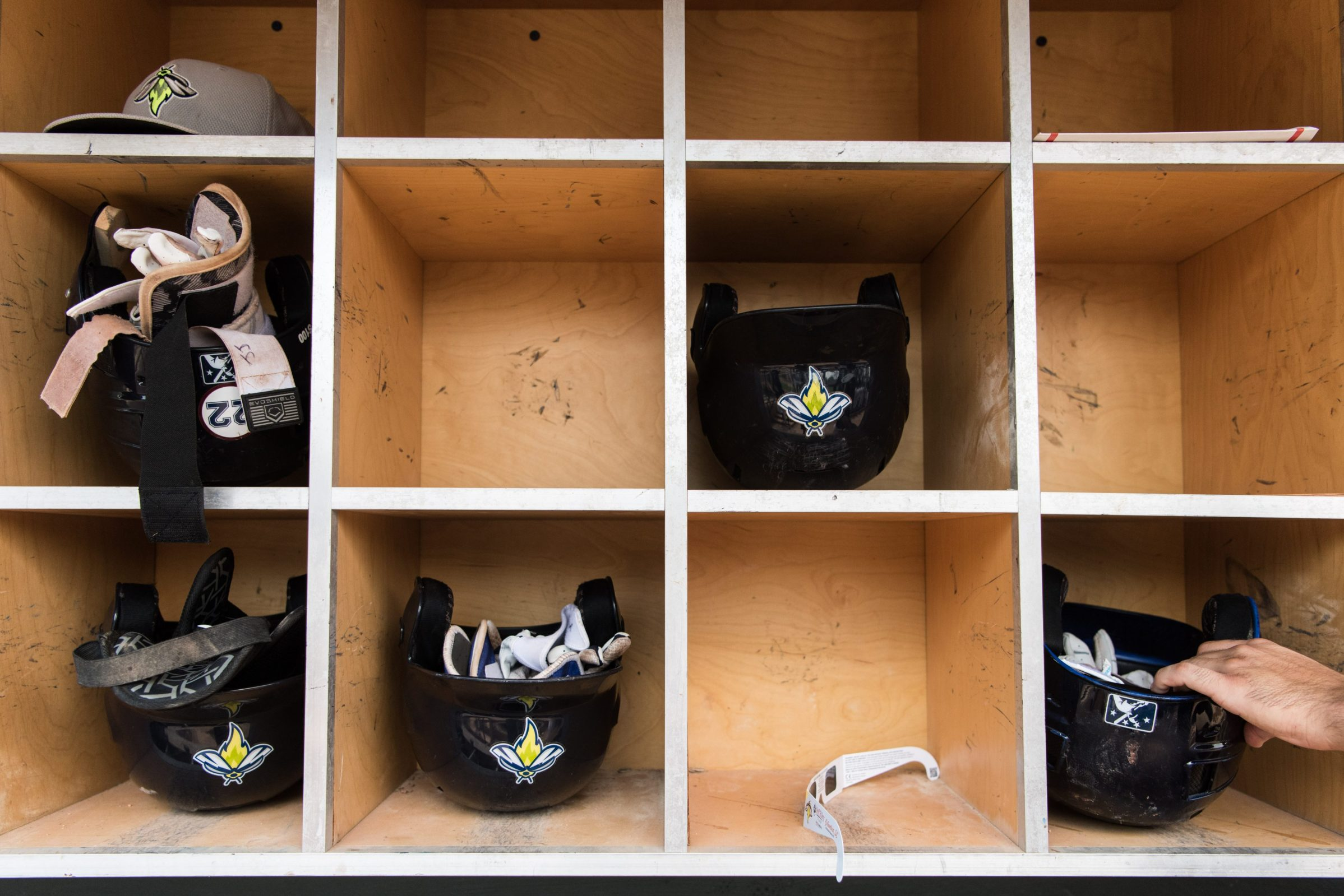 Helmets (and a pair of eclipse glasses) in the dugout of a minor league baseball team in Columbia, SC.
