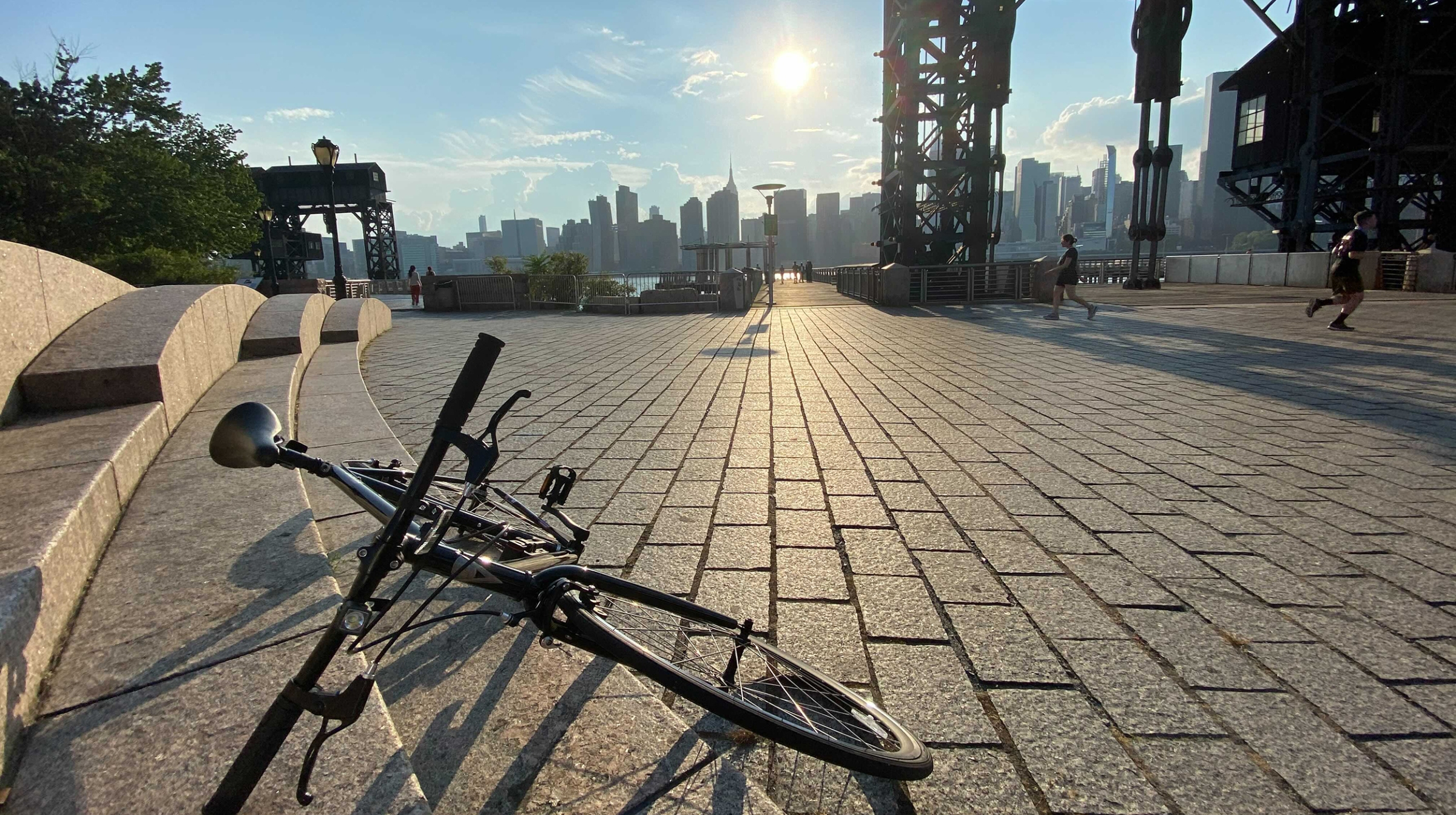 A bike rests by the waterfront in Queens, New York