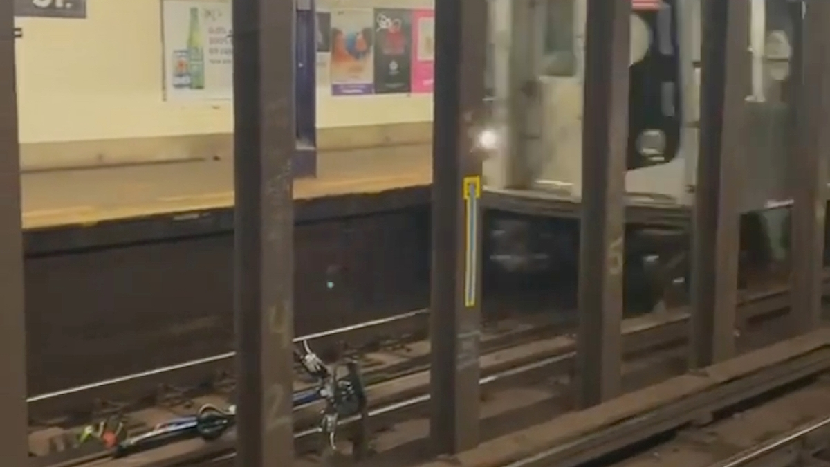 A train about to collide with a bike.