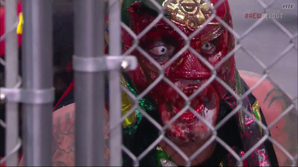 Penta El Zero Miedo covered in blood at AEW All Out